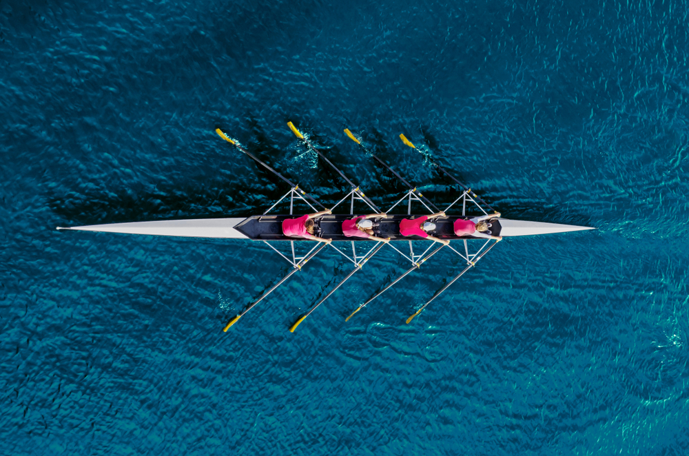 people rowing together