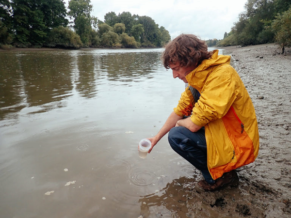 London Waterkeeper's Theo Thomas staking a water sample  Photo Credit: London WaterKeeper